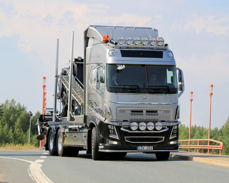 LEMPAALA, FINLAND - AUGUST 7, 2014  Swedish show truck Volvo FH16 of Gunnarssons arrives at Lempaala as part of the truck convoy to Power Truck Show 2014 in Alaharma, Finland