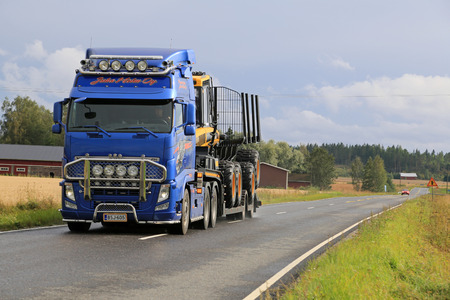 forwarder: SALO, FINLAND - AUGUST 23, 2014: Volvo FH13  hauls Ponsse forwarder on the road. According to Ponsses recent interim report, the demand for forest machines was at an extremely good level during the past quarter.
