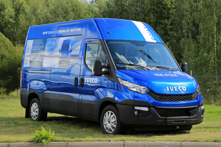 RAISIO, FINLAND - AUGUST 24, 2014: New Iveco Daily Van parked on grass. 80% of components in Iveco daily have been redesigned.