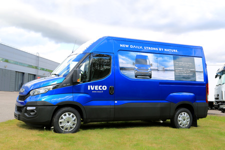 third wheel: RAISIO, FINLAND - AUGUST 24, 2014: New Iveco Daily Van parked on grass. 80% of components in Iveco daily have been redesigned. Editorial