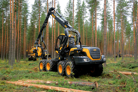 JAMSA, FINLAND - AUGUST 30, 2014: Ponsse harvester Scorpion at work. Ponsse presents its new Model Series 2015 at FinnMETKO 2014.