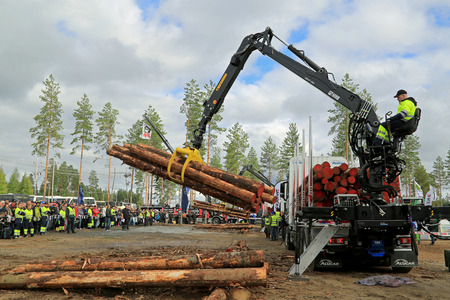JAMSA, FINLAND - AUGUST 29, 2014: Kari Heinonen places 2nd in the Finnish Championships in Log Loading 2014, held at FinnMETKO 2014.