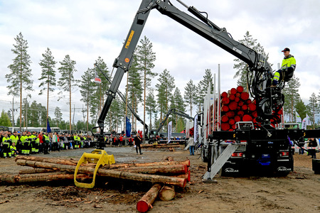 JAMSA, FINLAND - AUGUST 29, 2014: Unidentified finalist in the Finnish Championships in Log Loading 2014, held at FinnMETKO 2014.