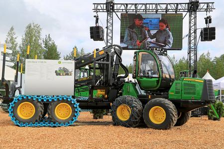 deere: JAMSA, FINLAND - AUGUST 30, 2014: John Deere Forestry presents John Deere 1110 harvester 1110E with IT4 engine at FinnMETKO 2014. Editorial
