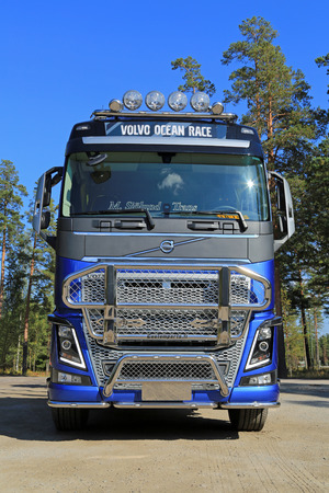 introduces: RAASEPORI, FINLAND - SEPTEMBER 14, 2014: Volvo Trucks introduces the FH16 in a specially designed version inspired by the tough sailing competition Volvo Ocean Race. Editorial