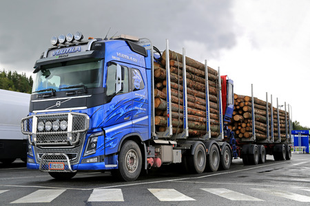 FORSSA, FINLAND - AUGUST 28, 2014: Volvo FH16 700 Timber truck with spruce log trailers. Metla reports 2% growth in Finnish timber trade in Jan-Aug 2014.