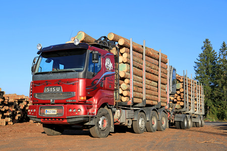 timber harvesting: LUVIA, FINLAND - SEPTEMBER 19, 2014: Sisu 18E630 Timber truck at sawmill lumber yard ready to unload. The Finnish Sisu Truck has Caterpillar C18 Engine of 630 hp. Editorial