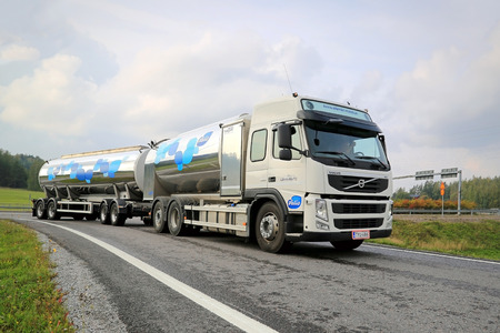SALO, FINLAND - SEPTEMBER 21, 2014: Volvo FM milk tank truck hauls Valio milk. The Valio milk  trucks collect 5 Million litres of milk from Finnish farms every day.