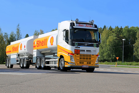 livery: RAUMA, FINLAND – SEPTEMBER 19, 2014: A Volvo FH truck hauls fuel in Shell livery. In September 2014, average price of diesel around the world is 1.17 US Dollar per liter. Editorial