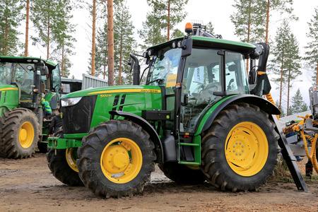 JAMSA, FINLAND - AUGUST 30, 2014: John Deere presents John Deere 5100M utility tractor at FinnMETKO 2014.
