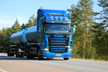 RAASEPORI, FINLAND - SEPTEMBER 28, 2014: Blue Scania tanker truck on the road. At IIA, Scania presents new innovations that provide significant fuel savings.