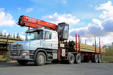 conventional: FORSSA, FINLAND - SEPTEMBER 27, 2014: Scania 124G year 2001 with log loader. Scania 4-series were manufactured in 1995-2004.
