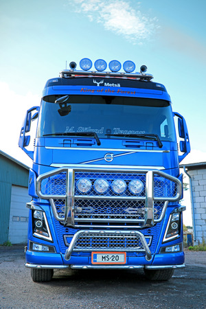 DEGERBY, FINLAND - SEPTEMBER 28, 2014: Volvo FH16 750 of M Sjolund Trans is the winner of the Timber Truck category in Power Truck Show 2014, Finland.