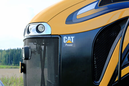tracked: SALO, FINLAND -SEPTEMBER 6, 2014: Detail of Challenger MT765C tracked tractor with Caterpillar engine. Caterpillar is named to Dow Jones Sustainability Indices for the 13th year.