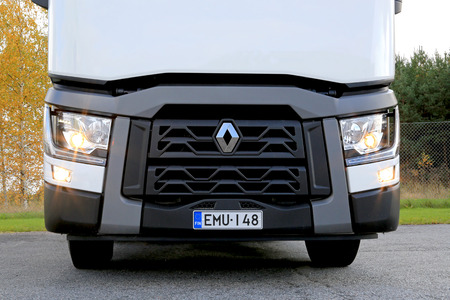 cornering: LIETO, FINLAND - OCTOBER 4, 2014: Renault T480 truck tractor with dipped beam lights and cornering lights on. Renault Trucks T is awarded the International Truck of the year 2015 by the jury of 25 international specialist journalists.