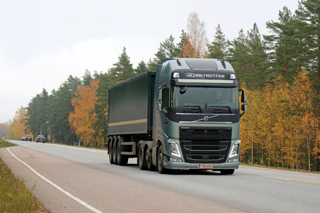 RAASEPORI, FINLAND - OCTOBER 12, 2014: Volvo FH semi truck on the road. Volvo FH has the new I-Shift Dual Clutch, which enables the driver change gears much faster.