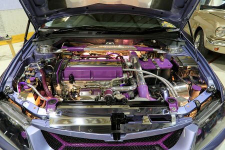 LOIMAA, FINLAND - JUNE 15, 2014:  Show car with open hood and tuned engine compartment at HeMa Show 2014 in Loimaa, Finland.