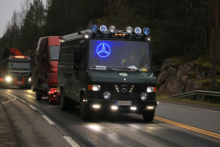 light duty: SALO, FINLAND - OCTOBER 25, 2014: Classic Mercedes-Benz van with led lights hauls another van. Vehicle styling with led lights has become increasingly popular in Finland. Editorial
