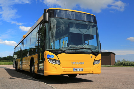 intercity: PAIMIO, FINLAND - JULY 19, 2014: Yellow Scania Citywide bus waits for passengers at a bus stop. Scania Citywide is a single-deck city or intercity bus available in low-floor and low-entry versions.