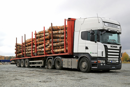 FORSSA, FINLAND - OCTOBER 5, 2014: Scania R480 Truck and Nurmi timber bunk with a load of birch logs. The timber bunks are made of high strength steel and have a capacity of 7 tonsbunk.