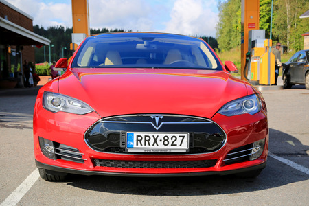 supercharger: SALO, FINLAND - SEPTEMBER 6, 2014: Tesla Model S electric car parked. In 2013, Tesla delivered 22,477 vehicles to customers worldwide.