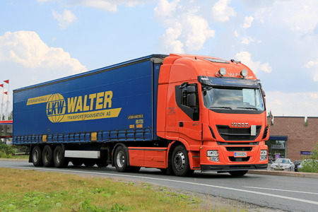 hiway: LEMPAALA, FINLAND - AUGUST 7, 2014: New Iveco Stralis Hi-Way Semi Truck on the road. The new Iveco heavy duty vehicle has Euro VI engines with patented HI-eSCR technology. Editorial