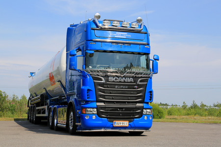 assessment system: TURKU, FINLAND - JULY 13, 2014: Blue Scania V8 tank truck for dry bulk transport on a yard.  A growing number of chemical companies use Cefic?s Safety and Quality Assessment System SQAS. Editorial
