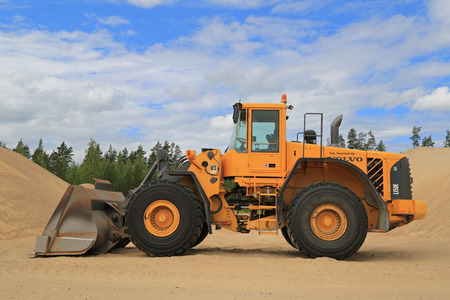 tl: KOSKI TL, FINLAND - JUNE 20, 2014: Volvo L150E Wheel loader at a sandpit. During its production years 2002-2007, Volvo L150E was equipped with tree different engines. Editorial