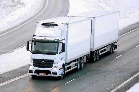 refrigerated: SALO, FINLAND - NOVEMBER 23, 2014: Mercedes-Benz Actros temperature controlled truck on motorway. Refrigerated trucks can haul a variety of goods that require a climate-controlled handling.