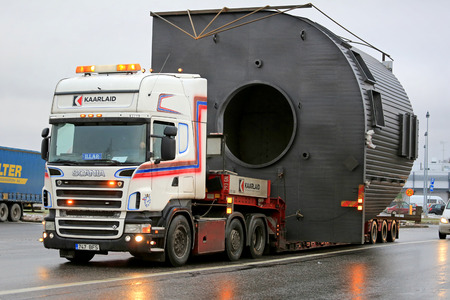FORSSA, FINLAND - NOVEMBER 30, 2014: Scania V8 truck hauls a wide load. On Finnish roads at least one escort vehicle is necessary, if the load exceeds 3,5 m in width.