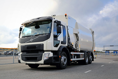 sanitation: NAANTALI, FINLAND – OCTOBER 11, 2014: White Volvo FE Euro 6 refuse truck parked. Volvo FE is a truck used for city or regional distribution, light construction, utilities and refrigerated transport jobs. Editorial