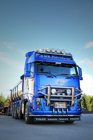 ice age: SOMERO, FINLAND - SEPTEMBER 27, 2014: Blue Volvo FH16 Asphalt truck features chrome accessories and airbrush paintings from the movie Ice Age.
