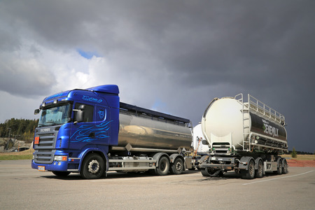 SALO, FINLAND -  MAY 2, 2014: Scania R480 tank truck and a trailer on a yard just before a thunderstorm.  Scania will deliver about 1500 biodiesel trucks in 2014.