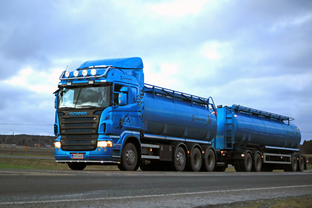 SALO, FINLAND - DECEMBER 21, 2014: Scania R500 tank truck on the road. The Scania R-series model range debuted in 2004, and won the prestigious International Truck of the Year award in 2005 and again in 2010.