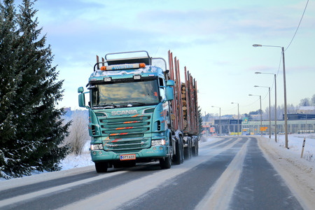 logging truck: SALO, FINLAND - DECEMBER 21, 2014: Scania R500 logging truck with full log load in winter. The Scania R-series model range debuted in 2004, and won the prestigious International Truck of the Year award in 2005 and again in 2010. Editorial