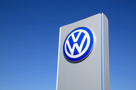 period of time: FORSSA, FINLAND - MAY 17, 2014: Sign Volkswagen against blue sky. The Volkswagen Group delivered over 9 million vehicles in period from January to November for the first time ever in 2014.