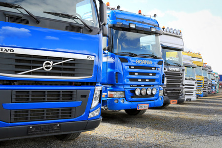 FORSSA, FINLAND - MAY 2, 2014: Row of used Volvo and Scania trucks. In Finland ca. 550 000 - 600 000 sales of used vehicles are made annually.