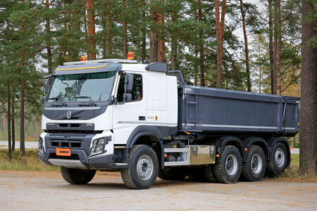 tipping: RAASEPORI, FINLAND - OCTOBER 25, 2014: New Volvo FMX XPro 540 construction truck on a yard. Only available in Finland, the X-Pro designed and delivered all set for the Finnish conditions. Editorial