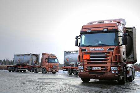 SALO, FINLAND - JANUARY 17, 2015: Scania R500 and Volvo FH tank trucks haul flammable goods. The ADR label 50-1495 stands for sodium chlorate. Editorial