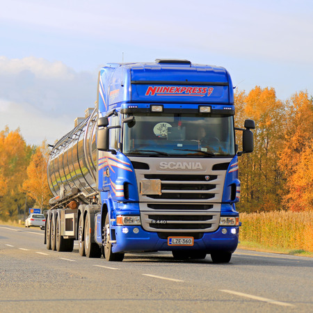world market: LIETO, FINLAND - OCTOBER 4, 2014: Blue Scania R440 tank truck transports chemicals. According to Cefic, The EU chemicals sales nearly double in 20 years, while its world market share halves.
