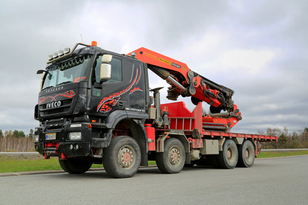 FORSSA, FINLAND - MAY 5, 2014: Iveco Trakker with Palfinger PK 85002 truck mounted crane. Launched in 1993, the Iveco Trakker is a range of quarry and construction site vehicles. Editorial