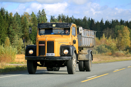 FORSSA, FINLAND - SEPTEMBER 27, 2014: Scania 110 truck on the road. The 110 belongs to the Scania 0-series which was manufactured between 1968-74.