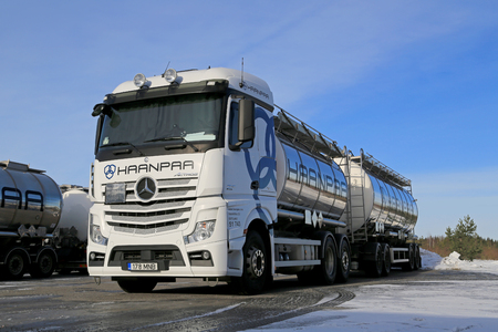daimler: LIETO, FINLAND - FEBRUARY 15, 2015: White Mercedes-Benz Actros Tank Truck on icy yard. Daimler Trucks sells nearly 500,000 trucks in 2014.