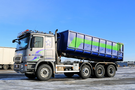 tipping: NAANTALI, FINLAND - FEBRUARY 15, 2015: Sisu Polar V8 tipper truck parked on icy yard. The 2010 introduced model with Mercedes-Benz components got the trade name Polar.