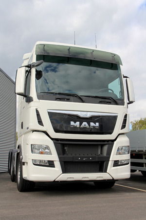 tonnes: TURKU, FINLAND - SEPTEMBER 15, 2013: TURKU, FINLAND - SEPTEMBER 15, 2013:  MAN TGX 26.480 Euro 6 truck tractor parked. According to the TUV Report 2014, MAN is the most reliable brand of truck weighing over 7.5 tonnes. Editorial