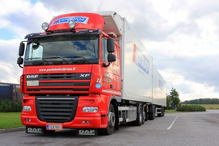 introduces: TURKU, FINLAND - SEPTEMBER 15, 2013: Red DAF XF105 truck with temperature controlled trailer parked. At the start of 2015, DAF introduces a large number of innovations that significantly contribute to transport efficiency. Editorial