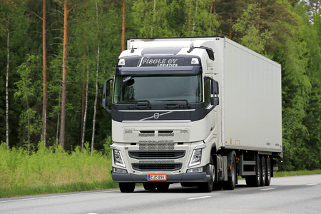 KOSKI, FINLAND - JUNE 1, 2014: White Volvo FH truck on the road. Volvo is the largest heavy-duty truck brand in the Nordic region with the market share of 39,8% in 2014.