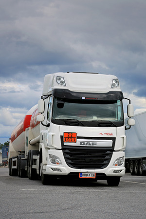 net income: FORSSA, FINLAND - AUGUST 16, 2014: DAF CF EURO 6 tank truck parked. PACCAR reports record annual revenues of $18.99 billion and net income of $1.36 billion for 2014.