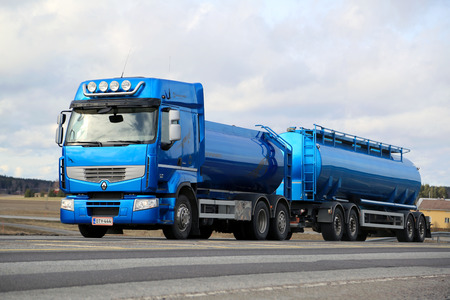 SALO, FINLAND - MARCH 22, 2015: Blue Renault Premium 460 tank truck on the road. Renault Trucks announces laboratory vehicle?s fuel consumption lowered by 22 % after intense testing.