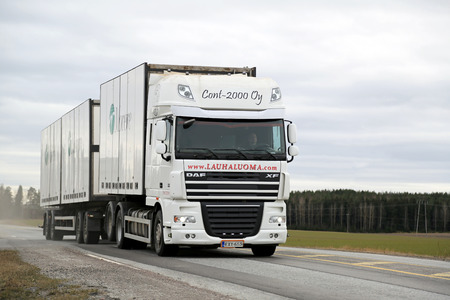 SALO, FINLAND - MARCH 22, 2015: DAF XF 105 full trailer truck on highway no. 52. PACCAR reports record annual revenues in 2014.